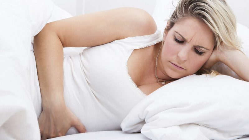 Woman with Postpartum Pain